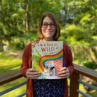 Zara González Hoang hold her book A New Kind of Wild
