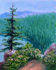 mountain scene with trees and water